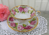 Vintage Pink Roses and Gold Gilt Footed Teacup and Saucer