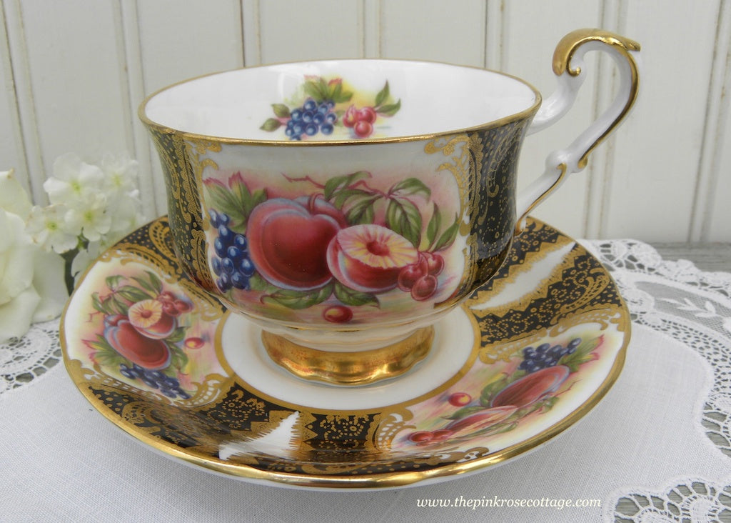Vintage Paragon Black and Gold Teacup and Saucer with Harvest Fruits