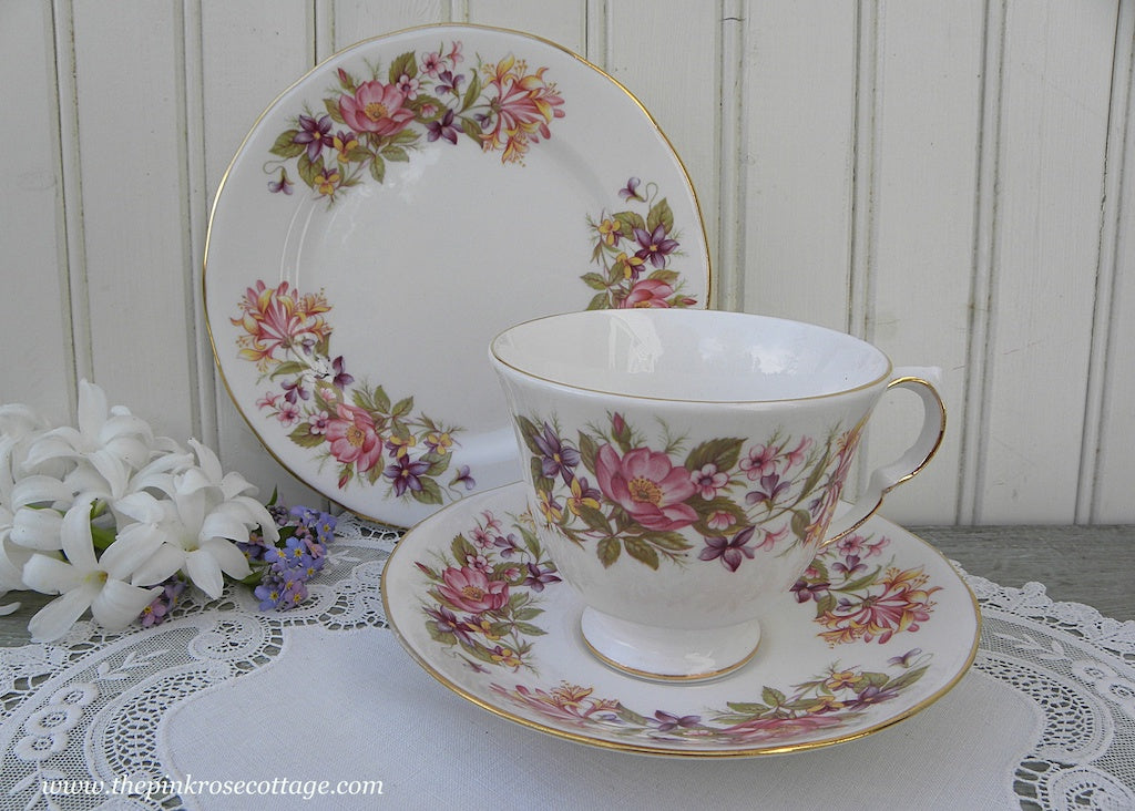 Vintage Teacup Saucer Dessert Plate with Wild Roses Honeysuckle and Violets