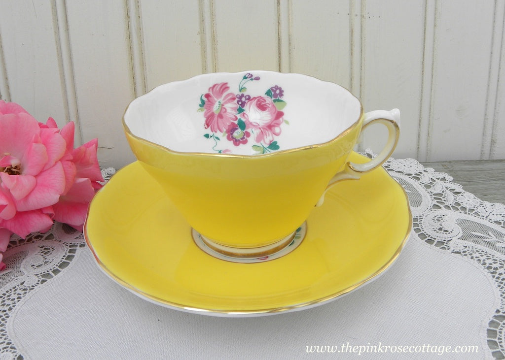Vintage Yellow Teacup and Saucer with Pink Roses and Daisies