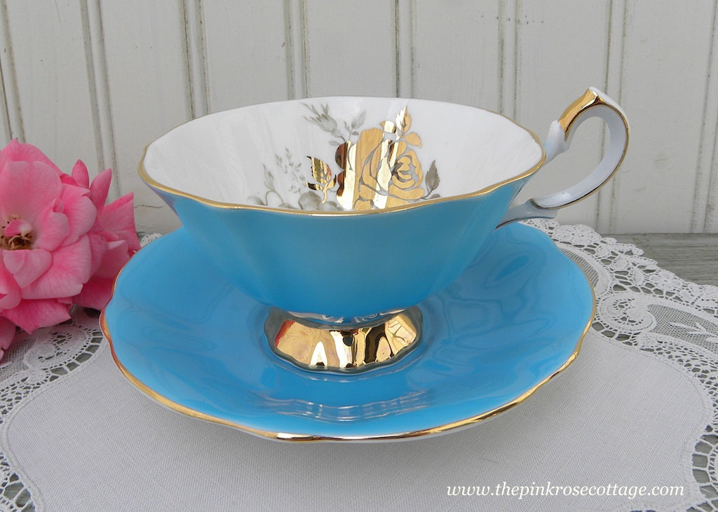 Vintage Queen Anne Blue Teacup and Saucer Gold Roses