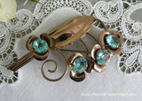 Vintage Gold Tone Flower and Leaf Brooch Pin with Large Aqua Rhinestones