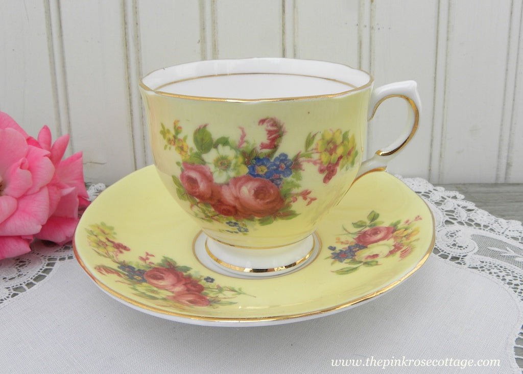 Vintage Yellow Teacup and Saucer with Cabbage Rose Bouquets