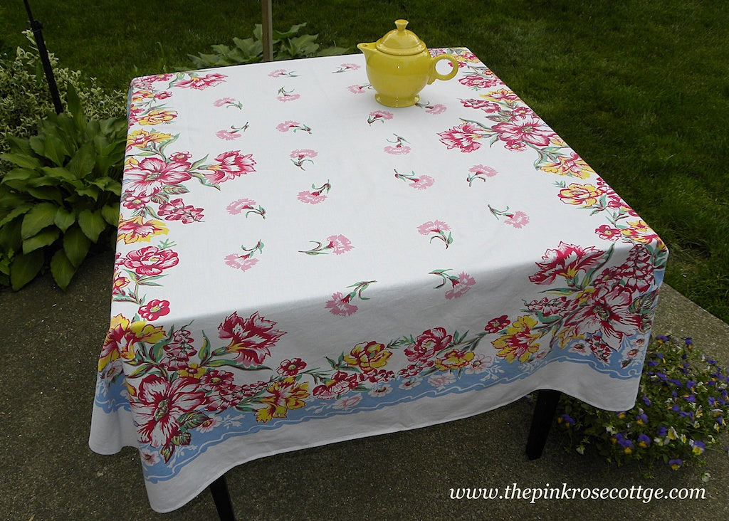 Vintage Pink Carnations Foxgloves Lilies and More with Blue Tablecloth
