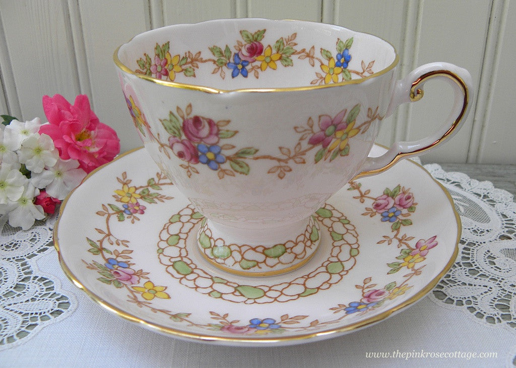 Vintage Tuscan Pink Teacup and Saucer with a Garland of Pink Roses and Forget Me Nots
