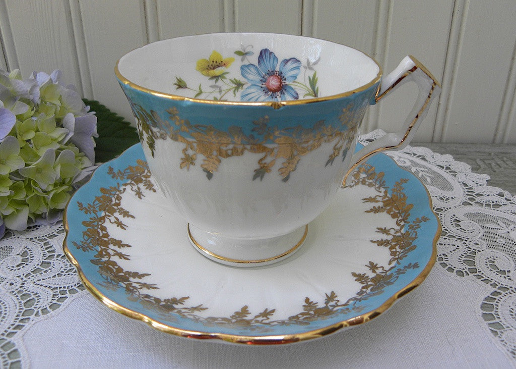 Vintage Aynsley Blue and Gold Teacup and Saucer with Wildflowers