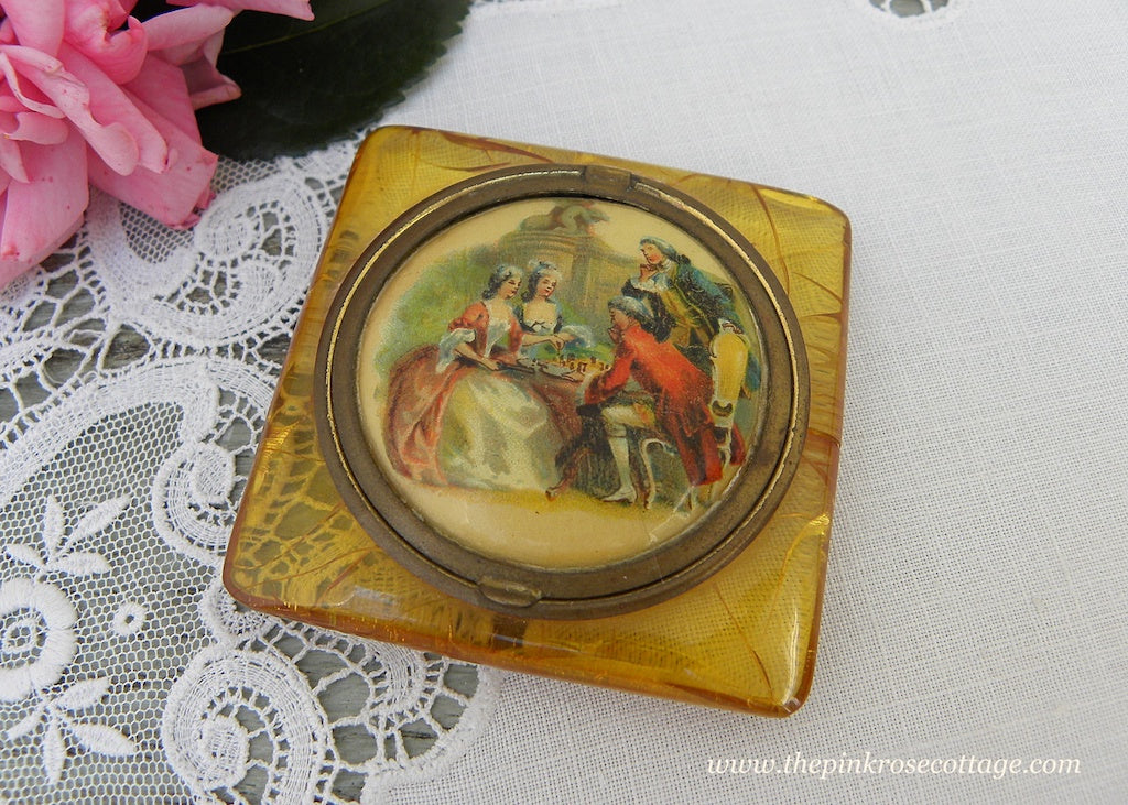 Vintage Amber Lucite Powder Compact with Romantic Couples Insert