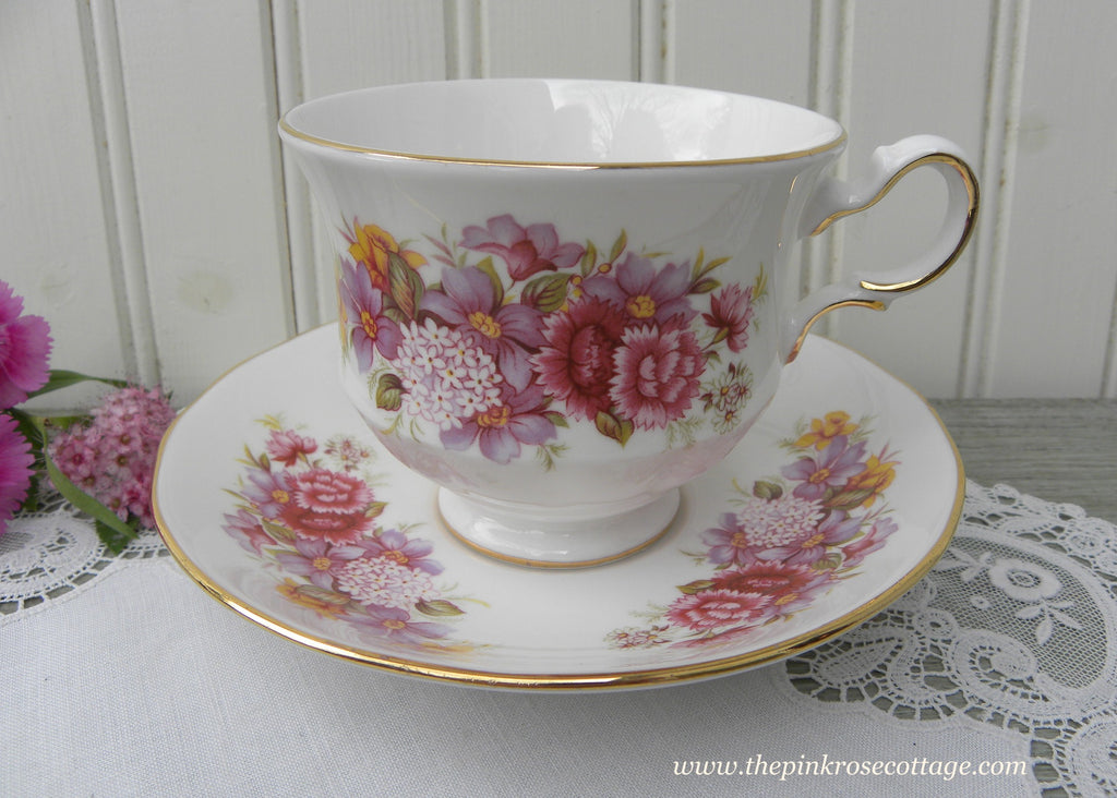 Vintage Queen Anne Pinks Violets Lilacs and Daffodil Teacup and Saucer