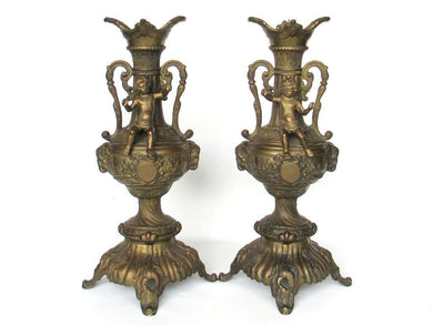 UpperDutch:Candelabras,Set of 2 ornate antique brass putti candlestick holders.