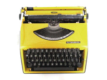 UpperDutch:Typewriter,Mustard Yellow Triumph Tippa made in 1977, QWERTY layout. Fully functional typewriter, vintage. Mustard yellow retro office decor.