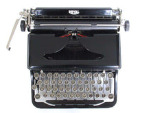 "UpperDutch:Typewriter,Royal portable typewriter, made in 1937. Black ""O"" model, fully functional and original. Black typewriter, working and decorative. QWERTY layout."