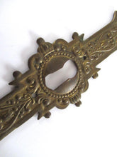 UpperDutch:Keyhole cover,1 (one) Stamped Escutcheon, Antique Brass Ornate Keyhole cover / plate.