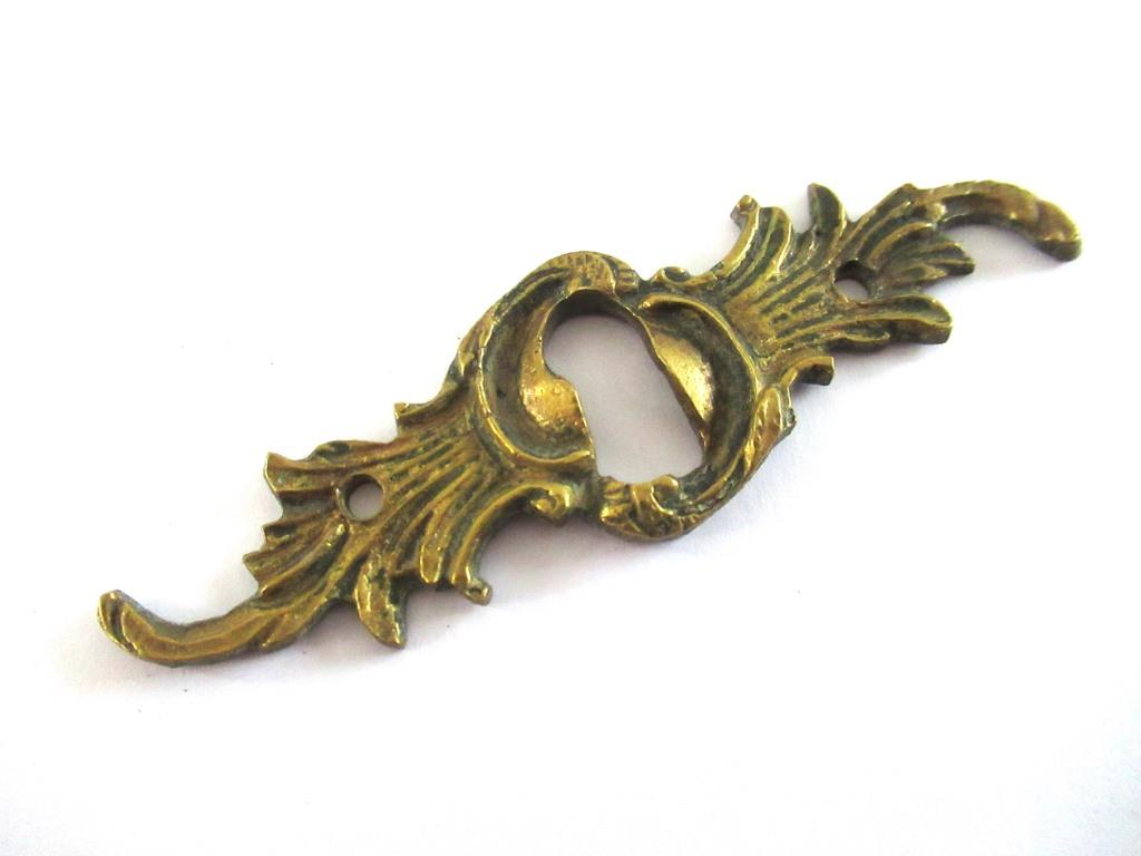 UpperDutch:Keyhole cover,Antique ornate brass keyhole cover. Ornamental escutcheon, cabinet hardware, furniture applique.