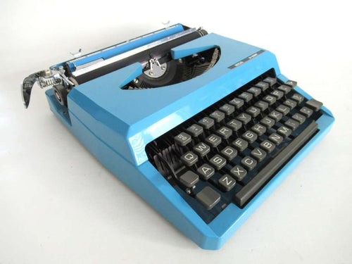 UpperDutch:Typewriter,Light Blue Lancia Typewriter 1970's QWERTY keyboard. Working blue typewriter. Retro office decor, desk decor. Functional typewriter.
