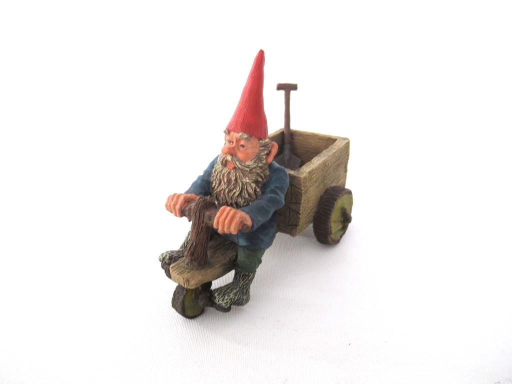 'Thomas' Gnome riding a cargo bike with shovel. Gnome figurine after a design by Rien Poortvliet. Classic Gnomes series. AAAAAAA International Co. Ltd.