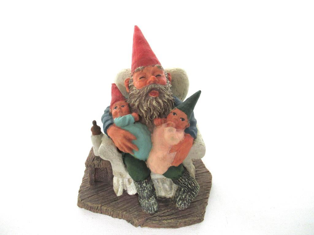 Gnome with grandchildren sitting in a chair figurine. 'Grandfather with Children' Part of the Classic Gnomes series designed by Rien Poortvliet