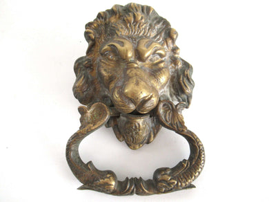 UpperDutch:Door knocker,Antique Solid Brass Detailed Lion Head Door Knocker with fish / carp handle.
