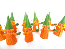 UpperDutch:Gnome,1 (ONE) Gnome figurine, Gnome after a design by Rien Poortvliet, Brb Gnome holding candle, Lisa the Gnome. Orange Pajamas