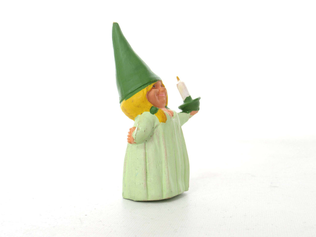 UpperDutch:,1 (ONE) Gnome figurine, Gnome after a design by Rien Poortvliet, Holding a candle, Lisa the Gnome. Green night gown, Pajamas. BRB
