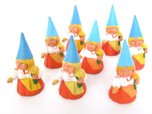 UpperDutch:Gnome,1 (ONE) Gnome with flowers figurine in orange dress, Gnome after a design by Rien Poortvliet, Brb Gnome.