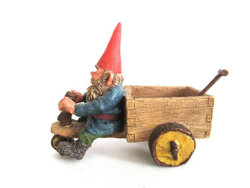 UpperDutch:Gnome,3086: 'Thomas' Gnome riding a cargo bike with shovel. Gnome figurine after a design by Rien Poortvliet. Classic Gnomes series. AAAAAAA International Co. Ltd.
