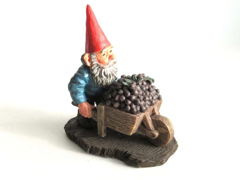 UpperDutch:,Classic Gnomes 'Christian' after a design by Rien Poortvliet. Gnome figurine transporting grapes with a wheelbarrow.