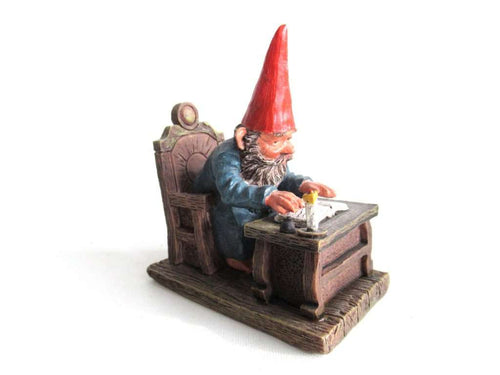 UpperDutch:Gnome,Classic Gnomes 'Rien' Gnome figurine after a design by Rien Poortvliet, Gnome reading by candlelight.