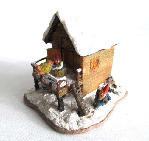 UpperDutch:Gnome,Classic Gnomes Villages 'House with Wren' after a design by Rien Poortvliet, feeding bird.