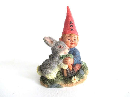 UpperDutch:Gnome,Gnome child with rabbit figurine.