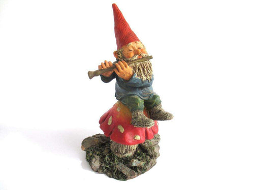 UpperDutch:Gnome,Gnome figurine 'Mo on Mushroom' after a design by Rien Poortvliet, Gnome on mushroom playing a flute. Classic Gnomes.