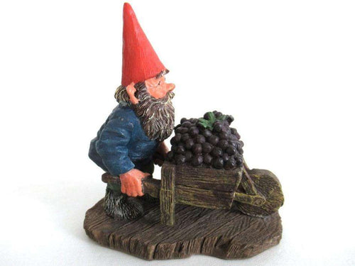 UpperDutch:Gnome,Gnome figurine transporting grapes with a wheelbarrow 'Christian'.  Classic gnomes series after a design by Rien Poortvliet.