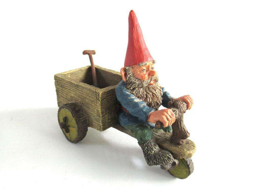 UpperDutch:,Gnome 'Thomas' riding a cargo bike with shovel. Gnome figurine after a design by Rien Poortvliet. Classic Gnomes series. AAAAAAA International Co. Ltd.