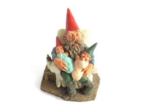 UpperDutch:Gnome,Gnome with grandchildren sitting in a chair figurine. 'Grandfather with Children' Part of the Classic Gnomes series designed by Rien Poortvliet
