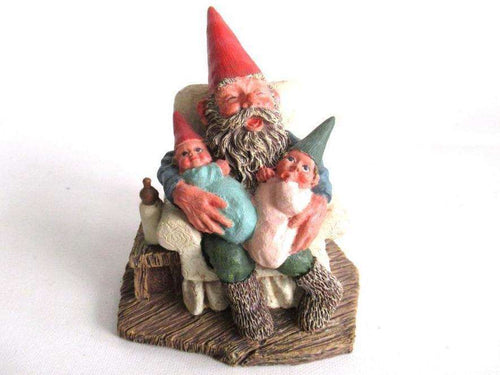 UpperDutch:Gnome,'Grandfather with Children' Gnome with grandchildren sitting in a chair figurine. Part of the Classic Gnomes series designed by Rien Poortvliet