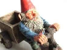 UpperDutch:,'Thomas' Gnome riding a cargo bike with shovel. Gnome figurine after a design by Rien Poortvliet. Classic Gnomes series. AAAAAAA International Co. Ltd.