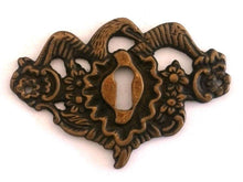UpperDutch:Hooks and Hardware,1 Antique solid brass bird keyhole frame, Antique ornate floral key hole plate. Escutcheon with flowers and a large bird wings.