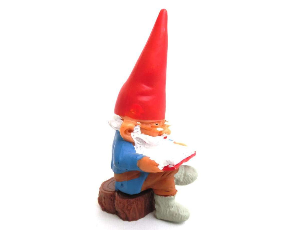 UpperDutch:Gnomes,Gnome, miniature Gnome after a design by Rien Poortvliet, Brb Gnome, David the Gnome, reading gnome sitting on a tree trunk.