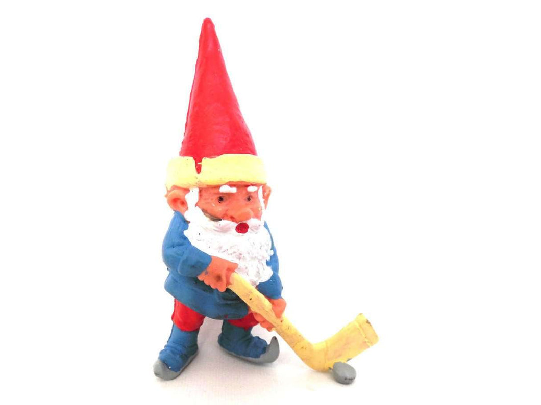UpperDutch:Gnomes,Gnome figurine, Gnome after a design by Rien Poortvliet, Brb Gnome, David the Gnome, gnome playing hockey.