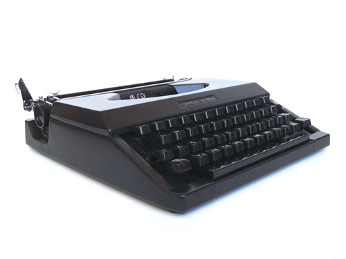 UpperDutch:Typewriter,Working Typewriter 1970's Matte black Torpedo Athena, QWERTY keyboard. Made in the 1970s. Man cave desk accessoire decoration.