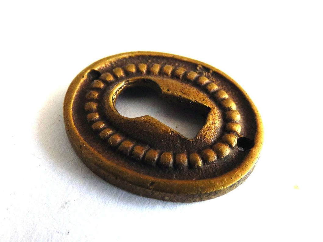 UpperDutch:Hooks and Hardware,1 (ONE) small Oval Keyhole cover, Antique brass escutcheon, key hole frame, plate.