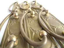 UpperDutch:Hooks and Hardware,1 (ONE) Old cabinet pull escutcheon with laurel design. NOS Brass Antique Drawer Handle with hanging pull. Restoration hardware.