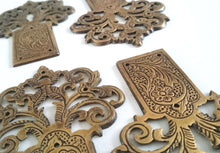 UpperDutch:Hooks and Hardware,Heavy solid brass tree / flower / floral ornament / escutcheon