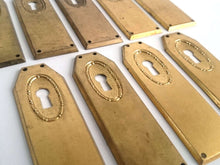UpperDutch:Hooks and Hardware,1 Keyhole Escutcheon metal Keyhole cover, stamped key hole frame, stamping plate.