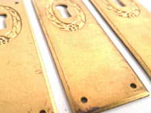 UpperDutch:Hooks and Hardware,1 Keyhole Escutcheon metal Keyhole cover, stamped keyhole frame, stamping plate.