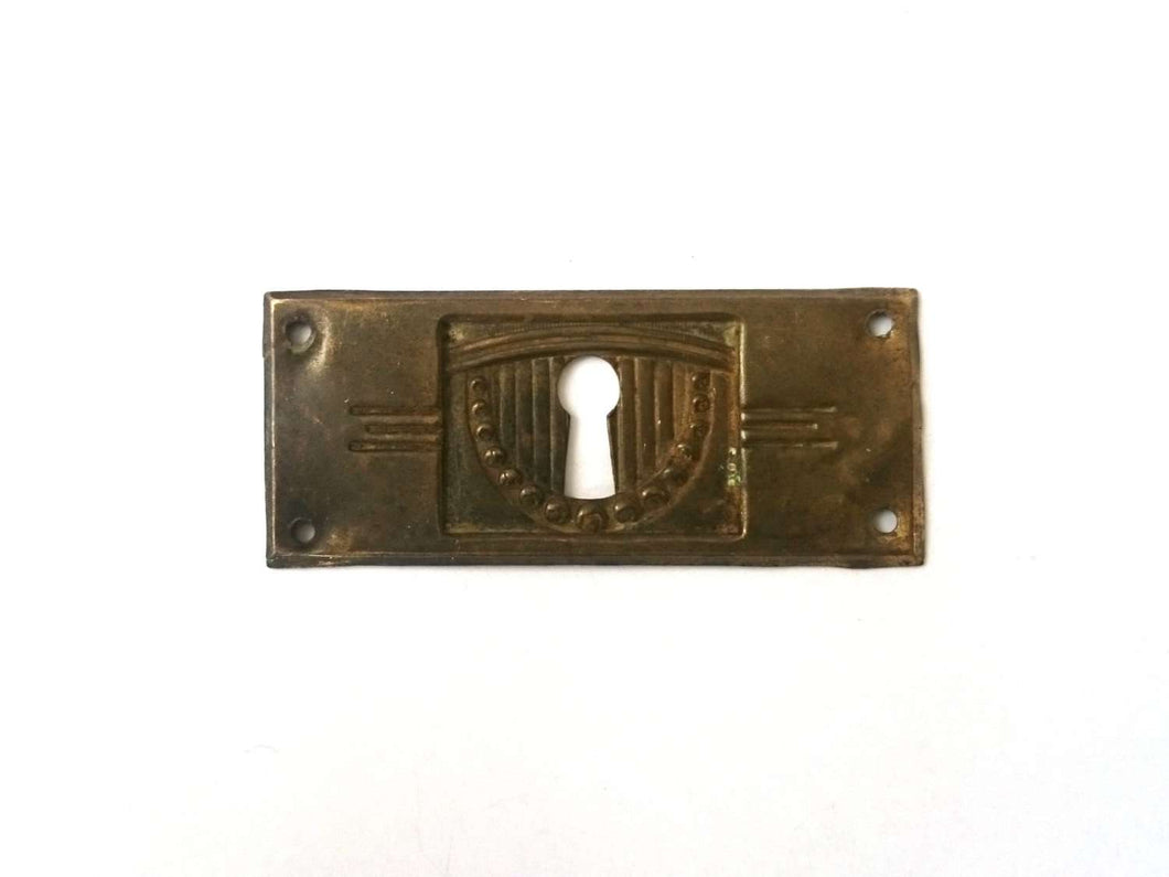 UpperDutch:Hooks and Hardware,Stamped Art deco Escutcheon, Distressed Floral Brass, Copper Keyhole cover with flowers.