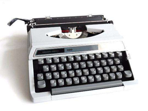 UpperDutch:Typewriter,Typewriter Silver-Reed 100, working gray portable typewriter 1970s Japan, QWERTY, Retro office. Working writing machine