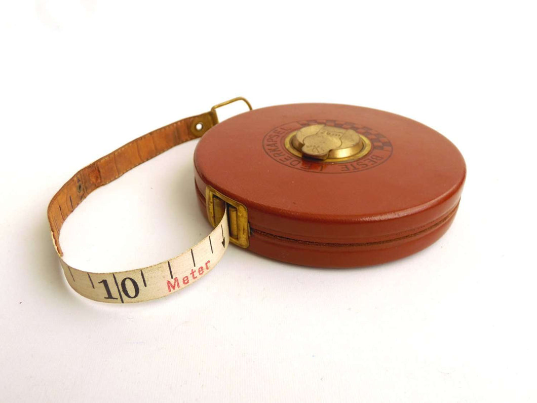 UpperDutch:Home and Decor,Tape measure, Stabila 25 meter leather wind up measuring tape. 'Beste lederkapsel' German tool, beautiful red and black numbers.