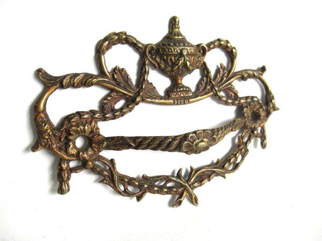 UpperDutch:Pull,An Antique Brass Drawer Handle. Detailed Furniture Applique with Pull. Empire embellishment. 19th century restoration hardware