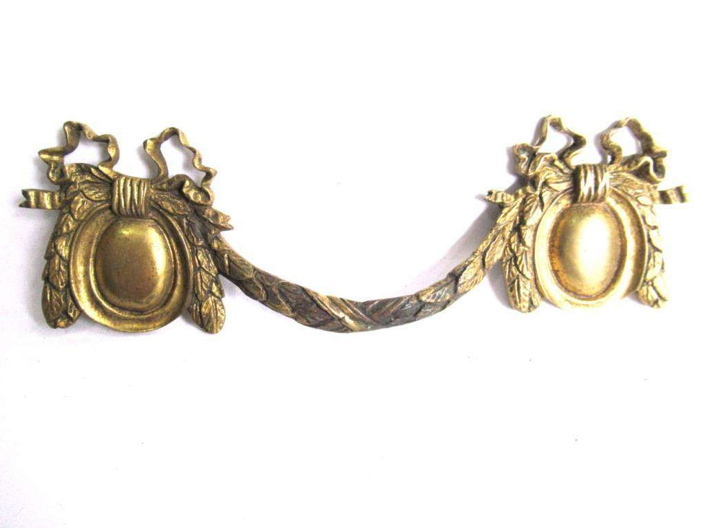 UpperDutch:,Antique Furniture Drawer Pull.Brass Drawer Handle. Empire embellishment. Authentic 1800's restoration hardware. No mounting holes