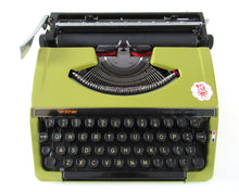 UpperDutch:Typewriter,Brother Deluxe 220 working typewriter. Green metal body, two tone ink ribbon. Portable writing machine.Office decor QWERTY layout
